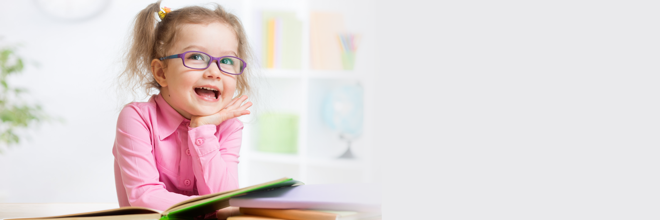 Young Child Reading while Wearing Glasses
