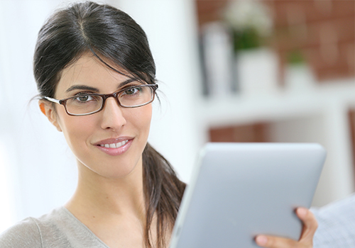 Professional Woman Wearing New Glasses while Working