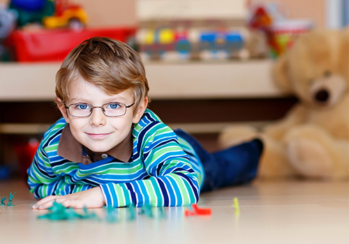 Young Child Playing while Wearing Glasses